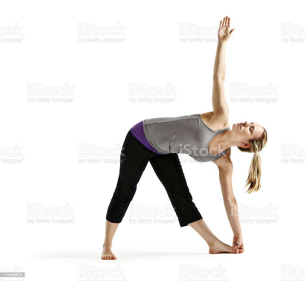 Woman demonstrating Utthita Trikonasana (Extended Triangle) yoga pose stock photo
