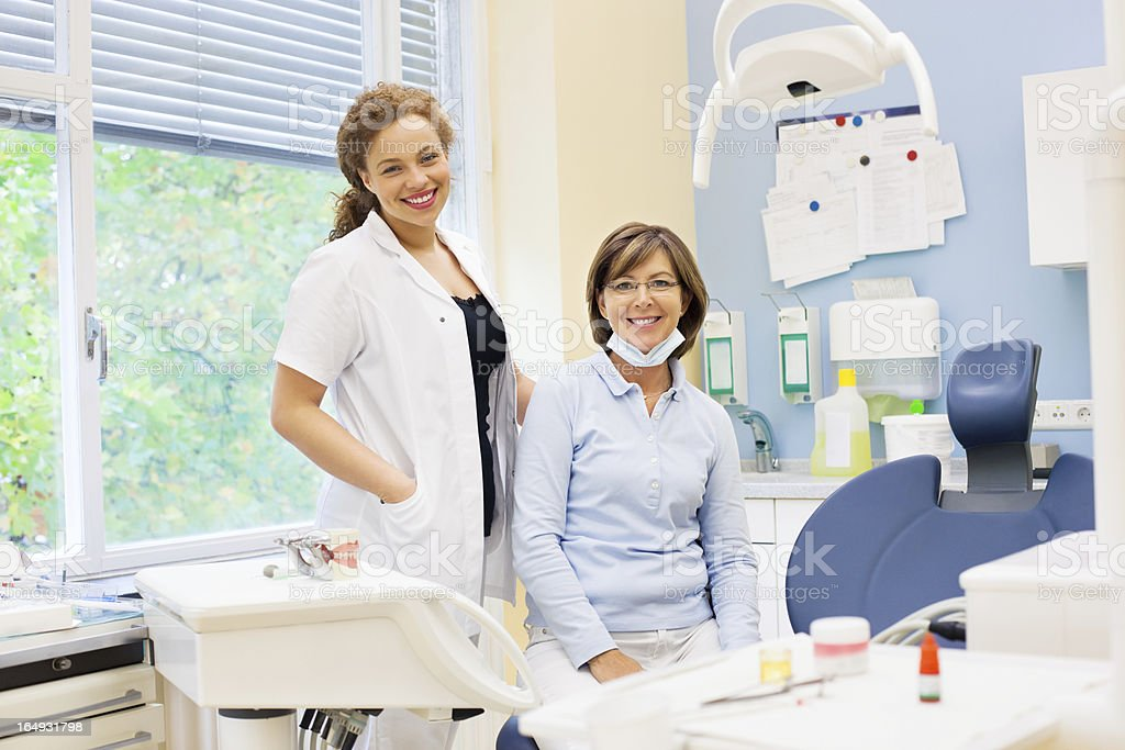 Woman dentist and her team stock photo