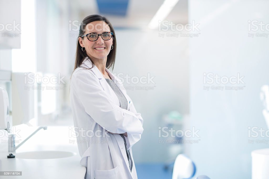 Woman dentist's portrait looking at camera. stock photo
