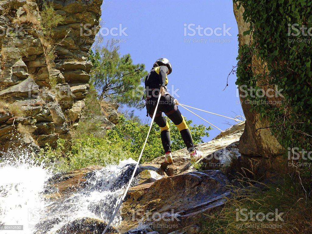 Woman descending on rappel stock photo