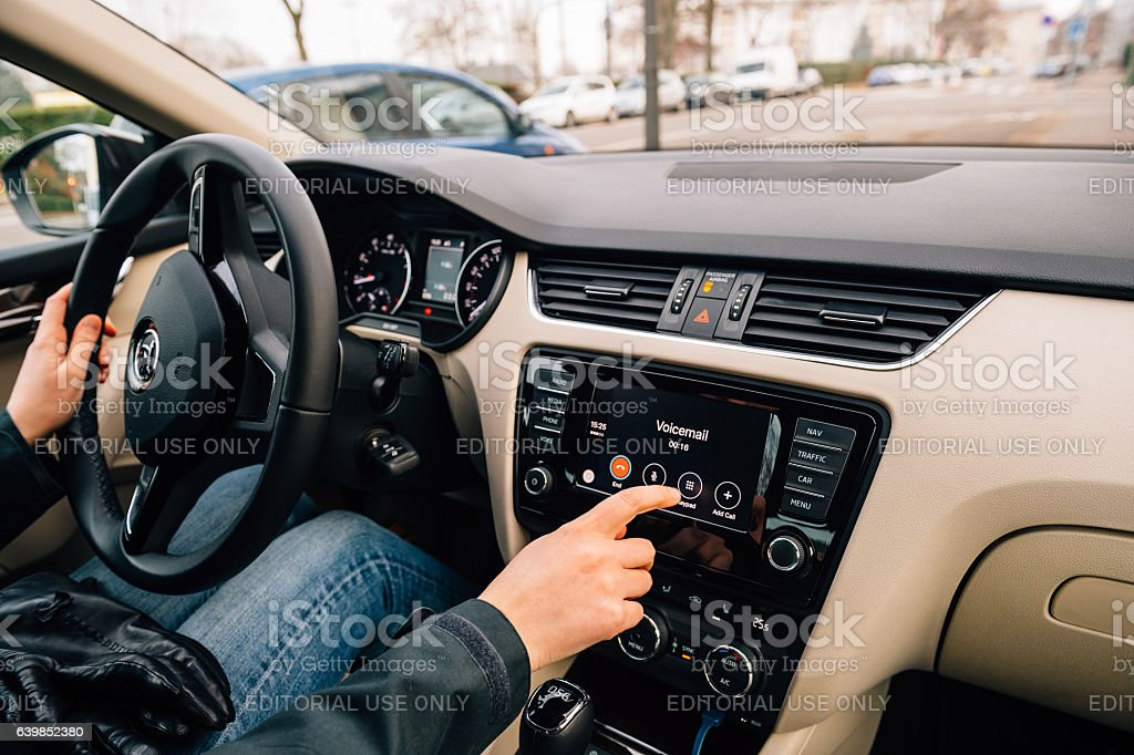 Woman dialing Voicemail on the Apple CarPlay stock photo