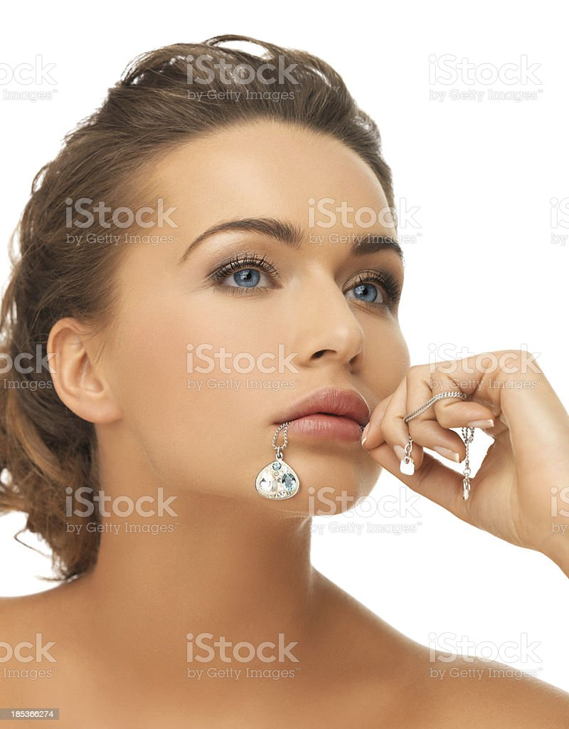 woman diamond pendant in mouth royalty-free stock photo