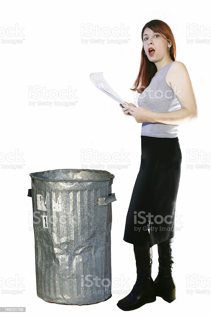 Woman digging in a trash can royalty-free stock photo