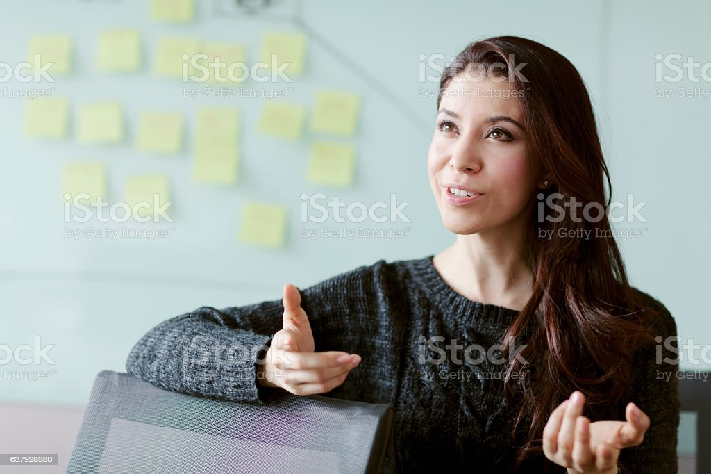 Woman discussing ideas and strategy in studio office stock photo