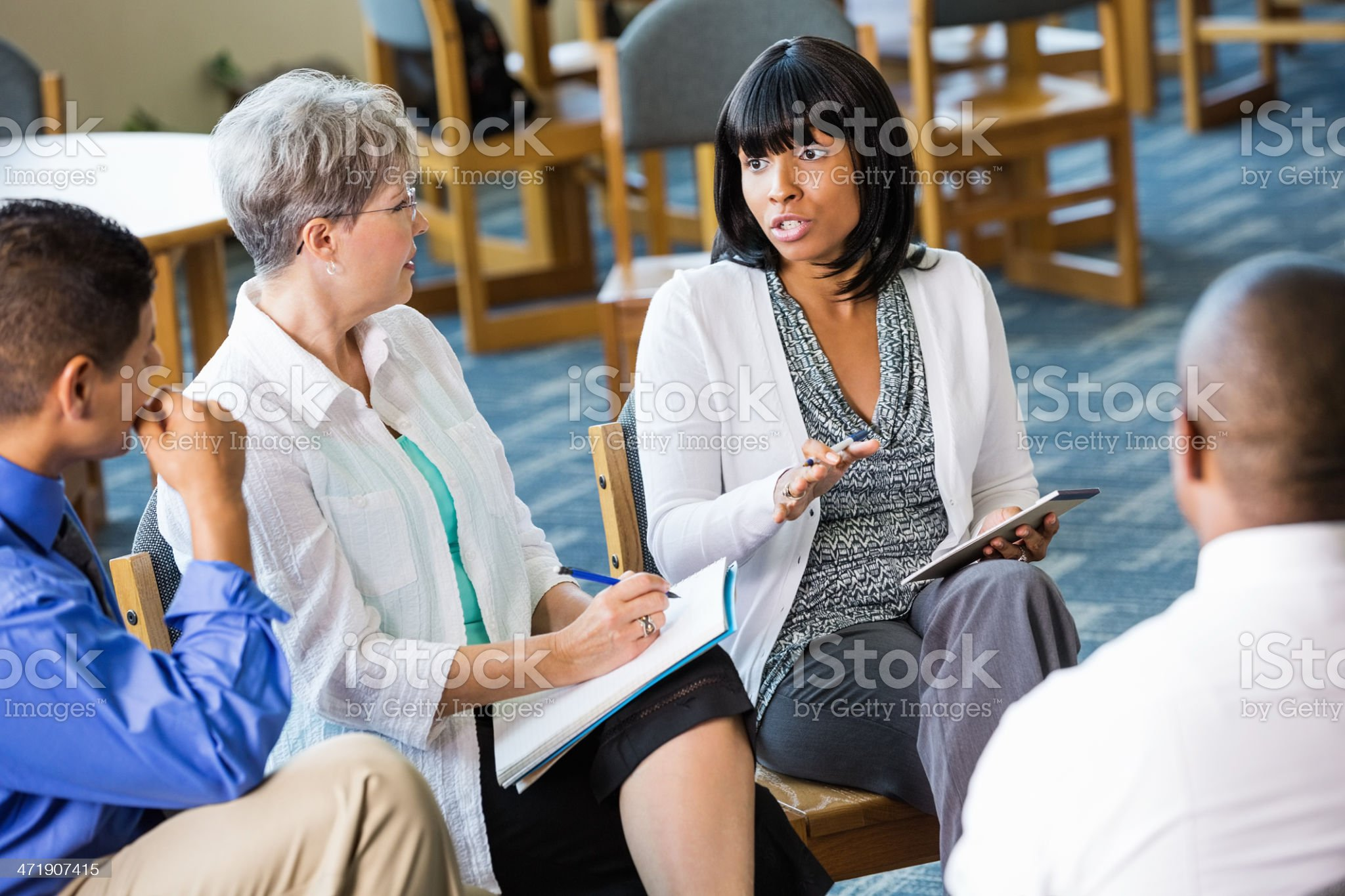 Woman discussing issue with senior counselor and support group royalty-free stock photo