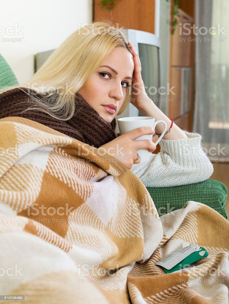 Woman dissolving medicine in glass stock photo
