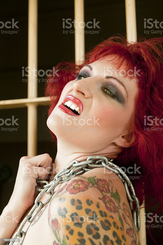 Woman Distraught, Prison Cell, Chain, Looking Up royalty-free stock photo