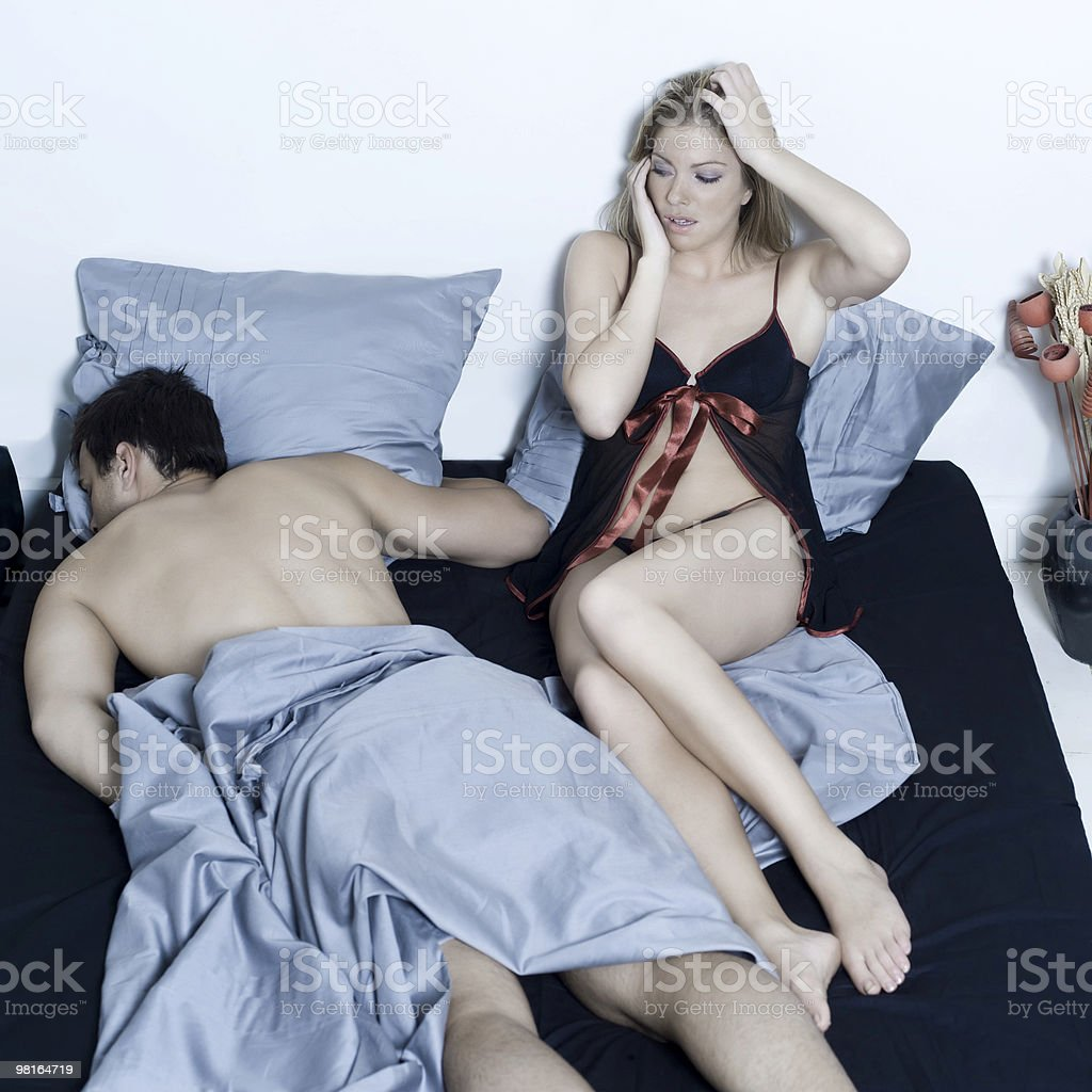 woman distraught with man sleeping the morming after royalty-free stock photo