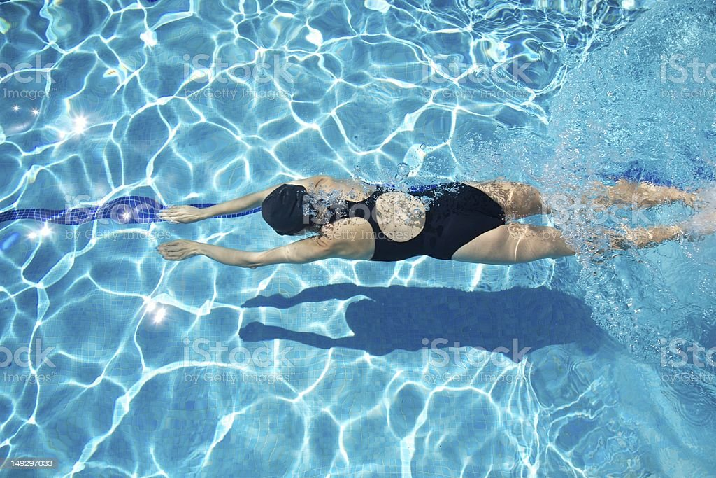 woman diving arms first stock photo