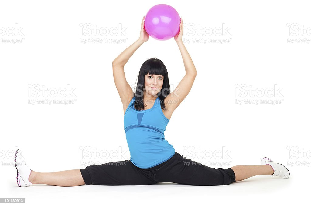 Woman do splits sitting holding ball royalty-free stock photo