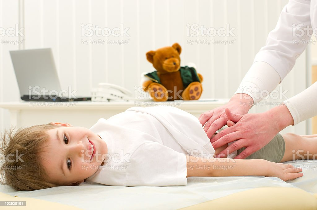 Woman doctor examining the patient stock photo