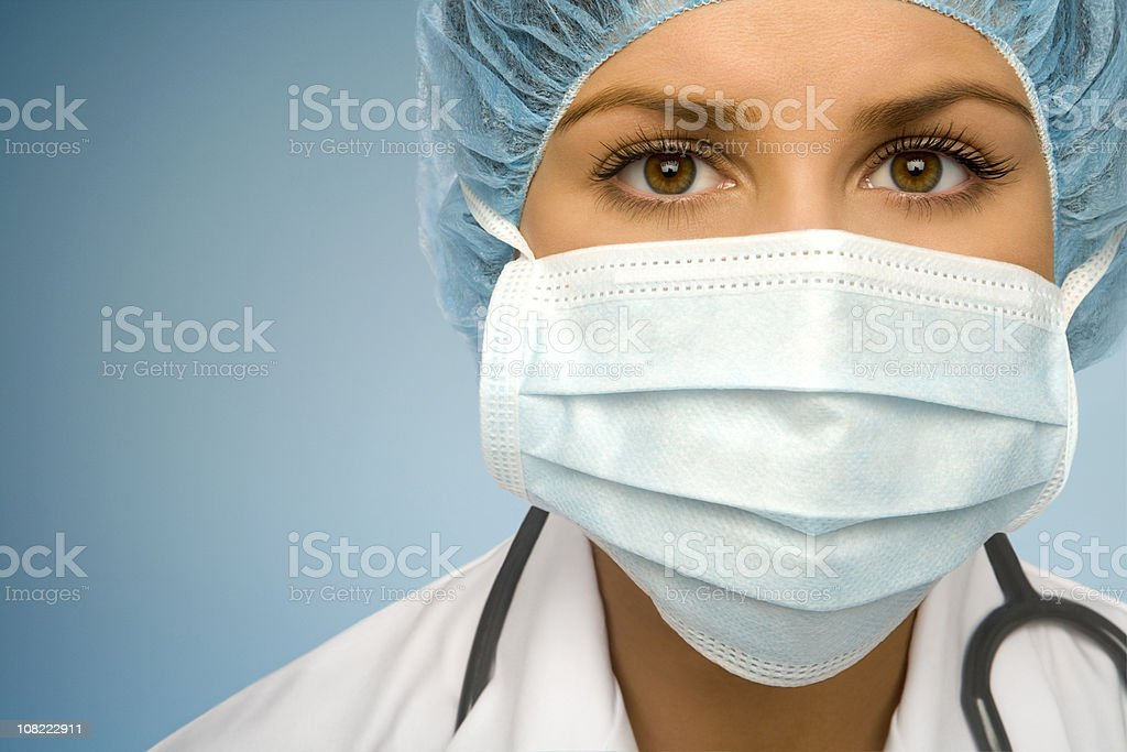 Woman Doctor Examining You stock photo