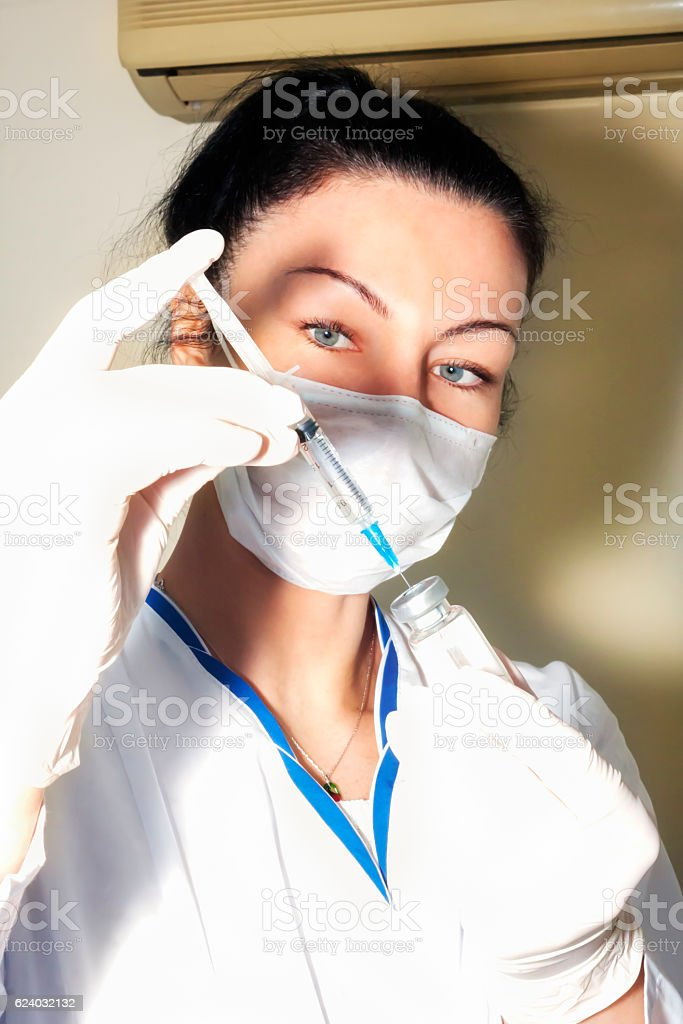 Woman doctor fills injection stock photo