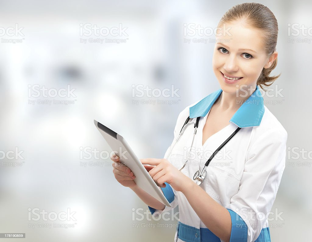 woman Doctor holding a tablet computer royalty-free stock photo
