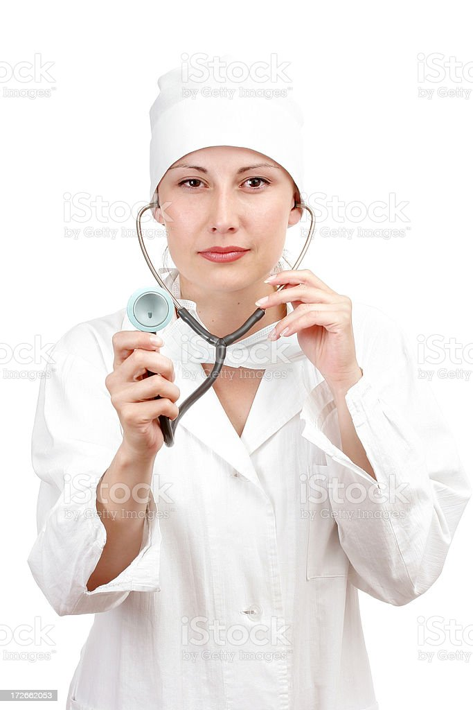 Woman doctor holding stethoscope royalty-free stock photo