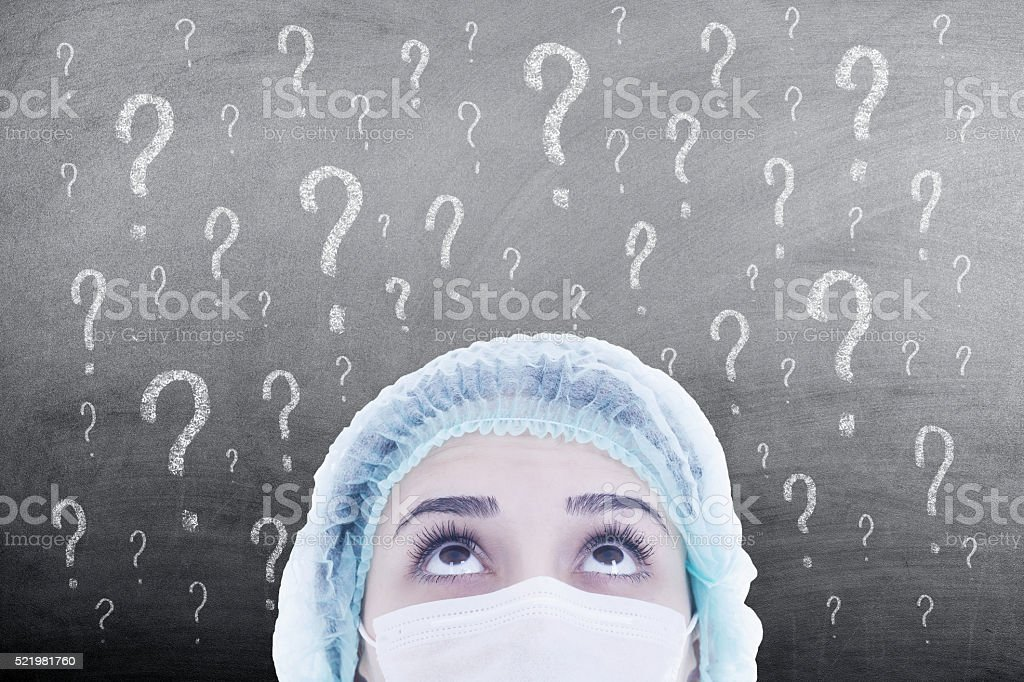 woman doctor thinking on blackboard stock photo