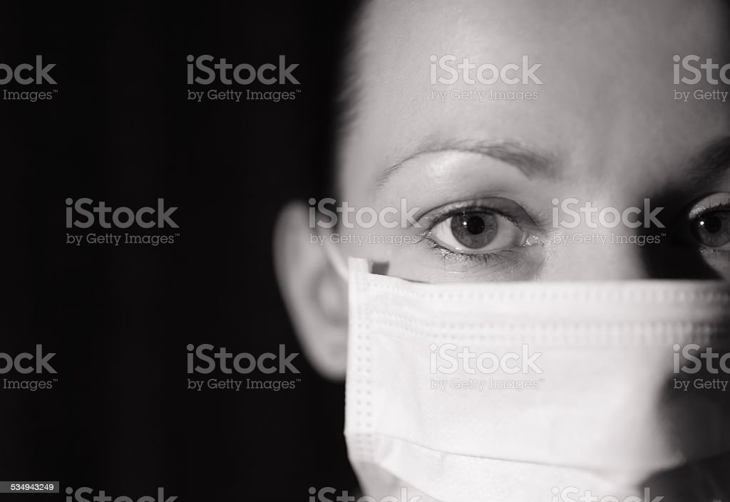 Woman doctor with a face mask stock photo