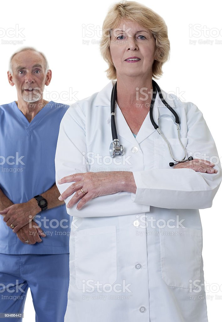 Woman doctor with arms folded and male nurse in back royalty-free stock photo