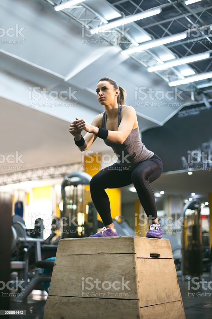 woman doing a box jump exercise stock photo