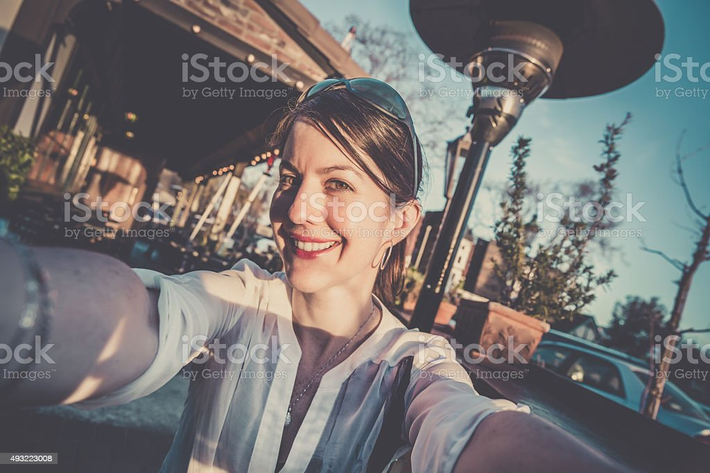 Woman Doing a Selfie During a Road Trip stock photo