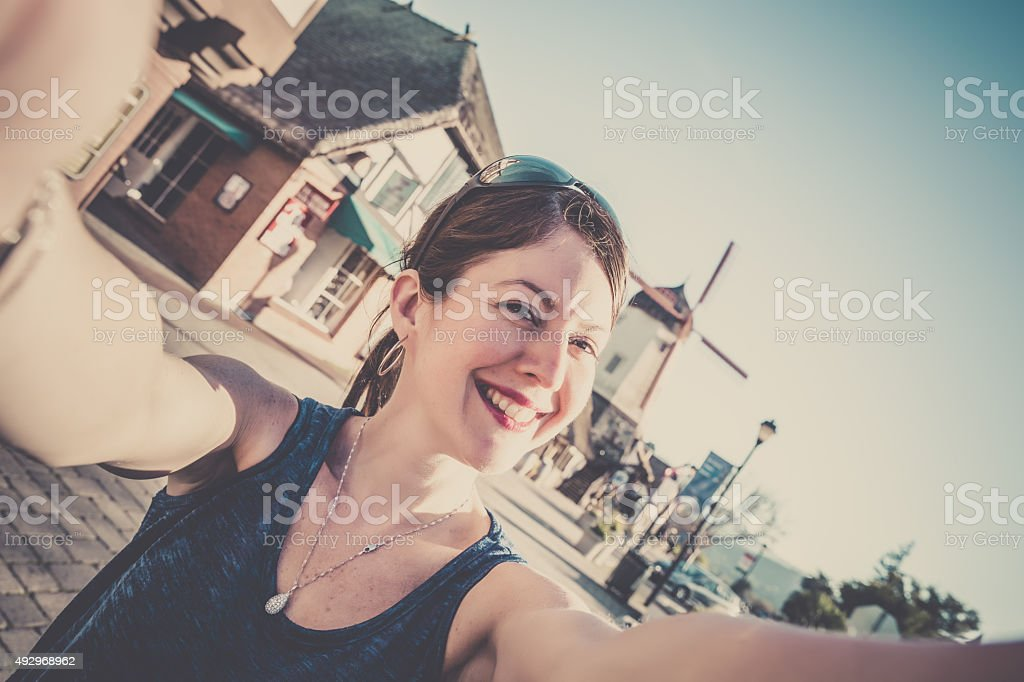 Woman Doing a Selfie in Solvang, California stock photo