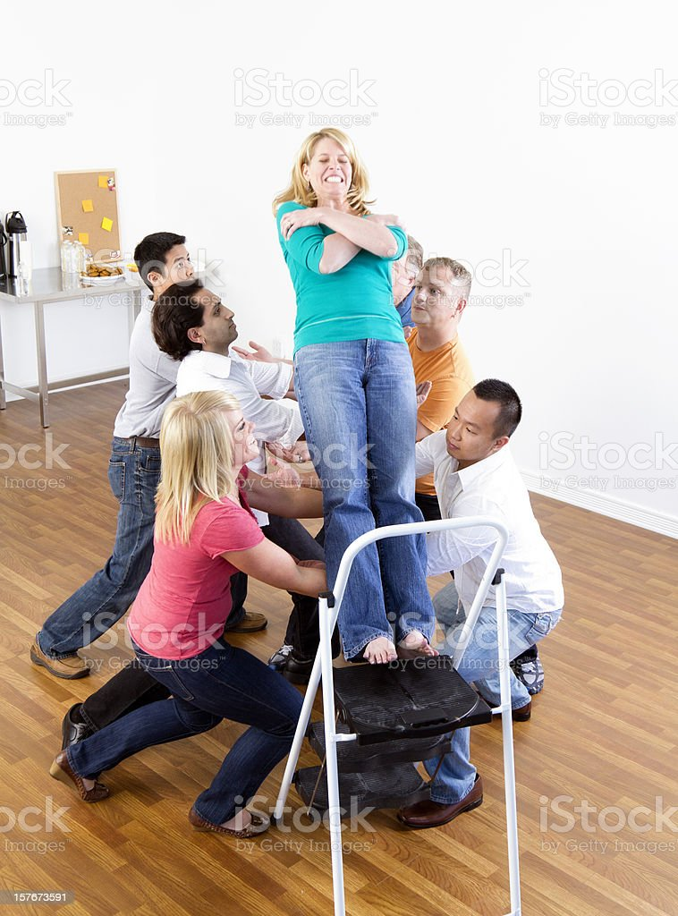 Woman Doing a Trust Fall royalty-free stock photo