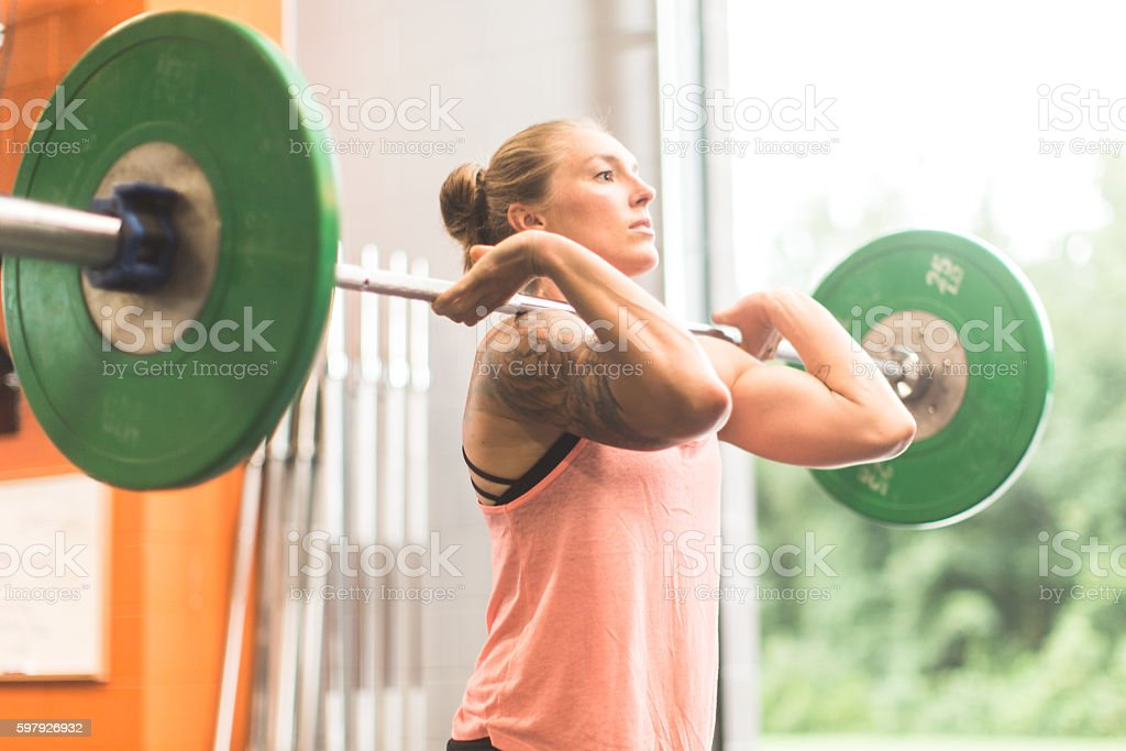 Woman doing a weightlifting cross training workout in the gym stock photo