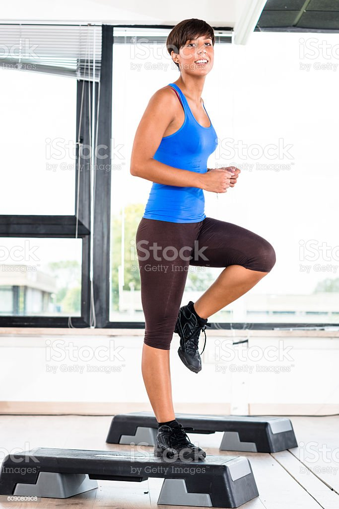 woman doing aerobics in the gym stock photo