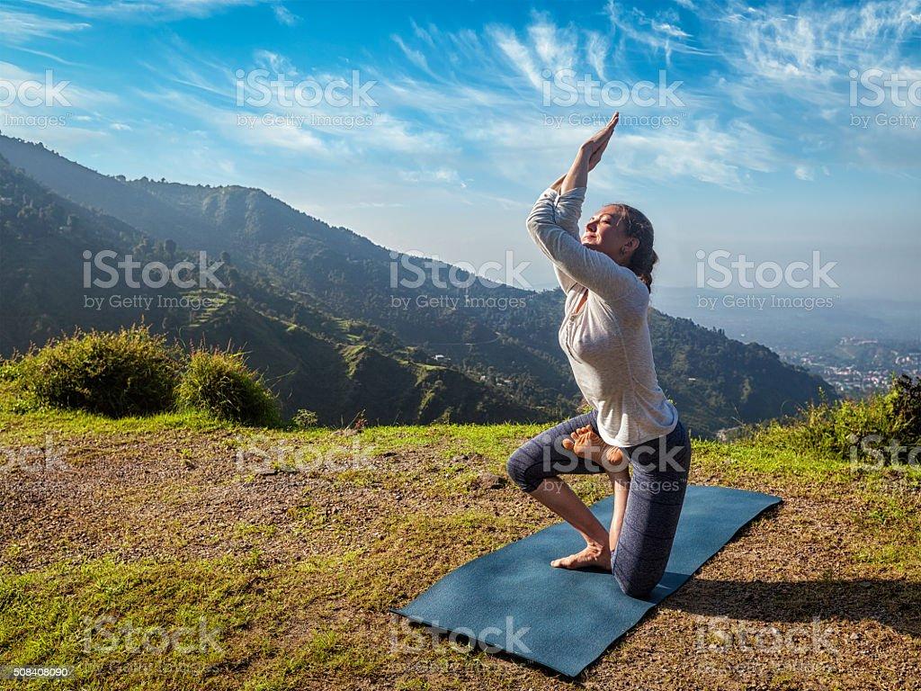 Woman doing Ashtanga Vinyasa yoga advanced asana stock photo