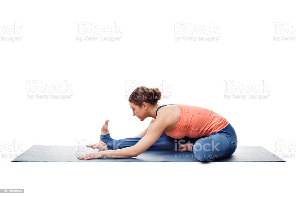 Woman doing Ashtanga Vinyasa Yoga asana Janu sirsasana stock photo