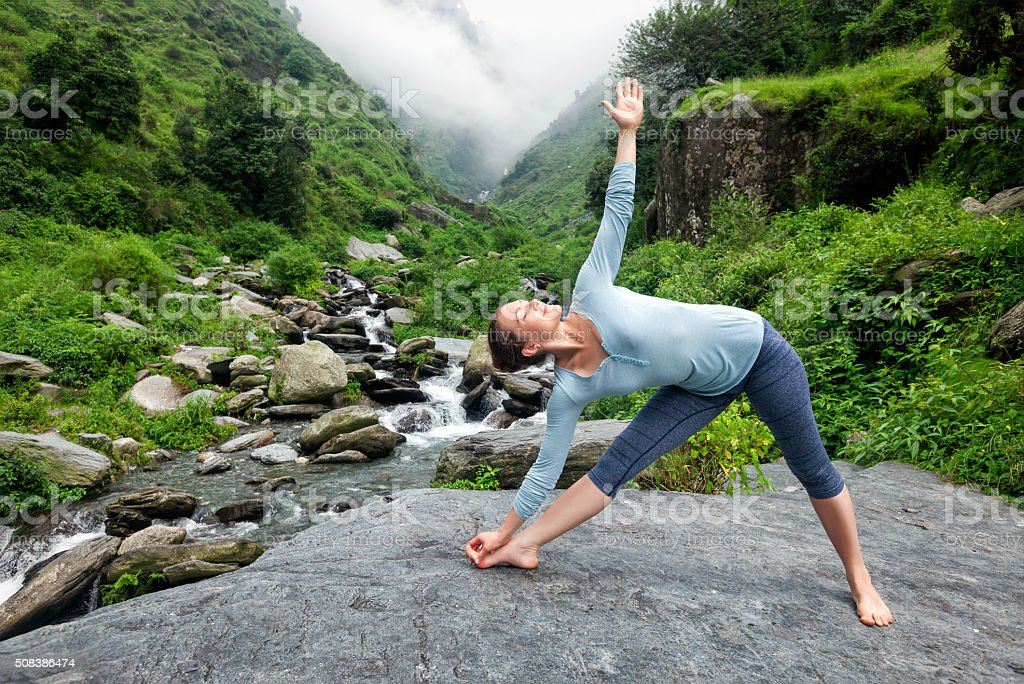 Woman doing Ashtanga Vinyasa yoga asana outdoors stock photo