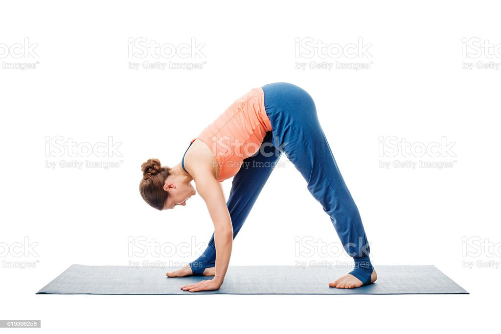 Woman doing Ashtanga Vinyasa Yoga asana Parsvottanasana stock photo