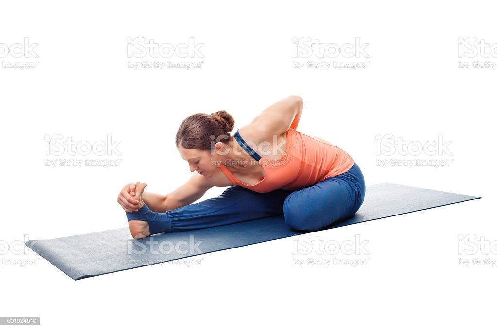Woman doing Ashtanga Vinyasa Yoga asana stock photo