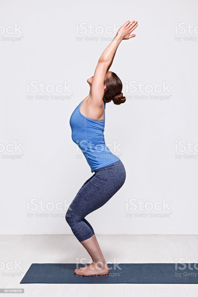 Woman doing ashtanga vinyasa yoga asana Utkatasana stock photo