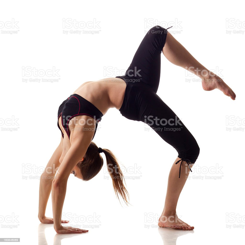 Woman Doing Back-Bend With Knee Raised royalty-free stock photo