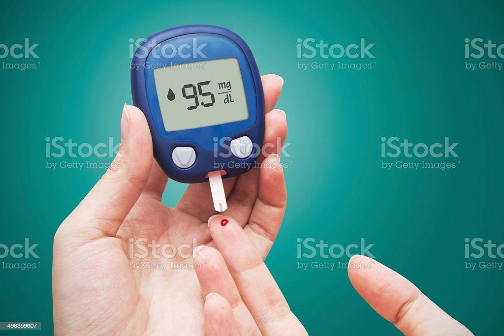 Woman doing blood sugar test royalty-free stock photo