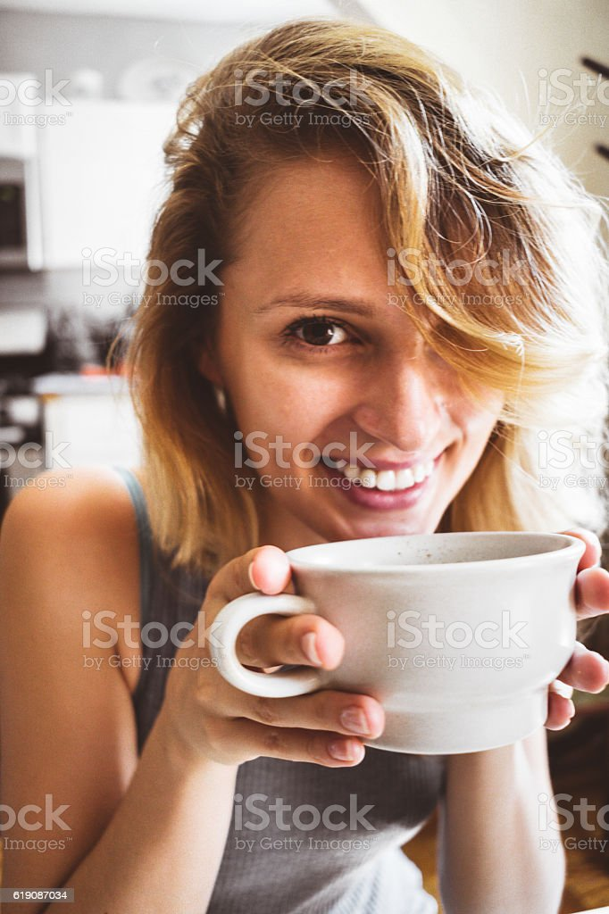 woman doing breakfast on the morning with coffee stock photo