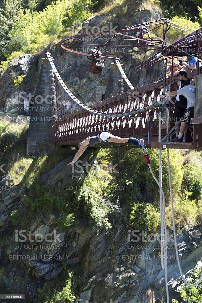 Woman Doing Bungee Jumping from Kawarau Bridge, Queenstown, New Zealand stock photo