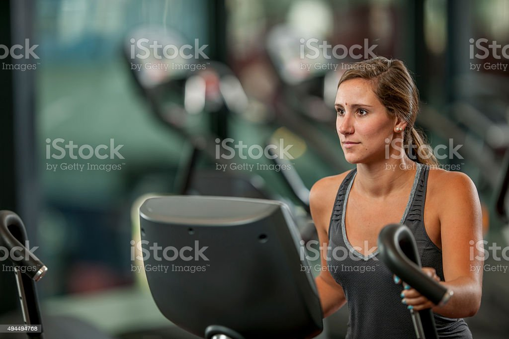 Woman Doing Cardio at the Gym stock photo