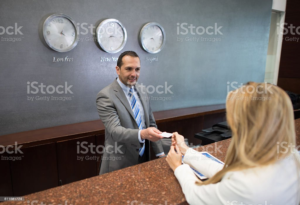 Woman doing check in at a hotel stock photo