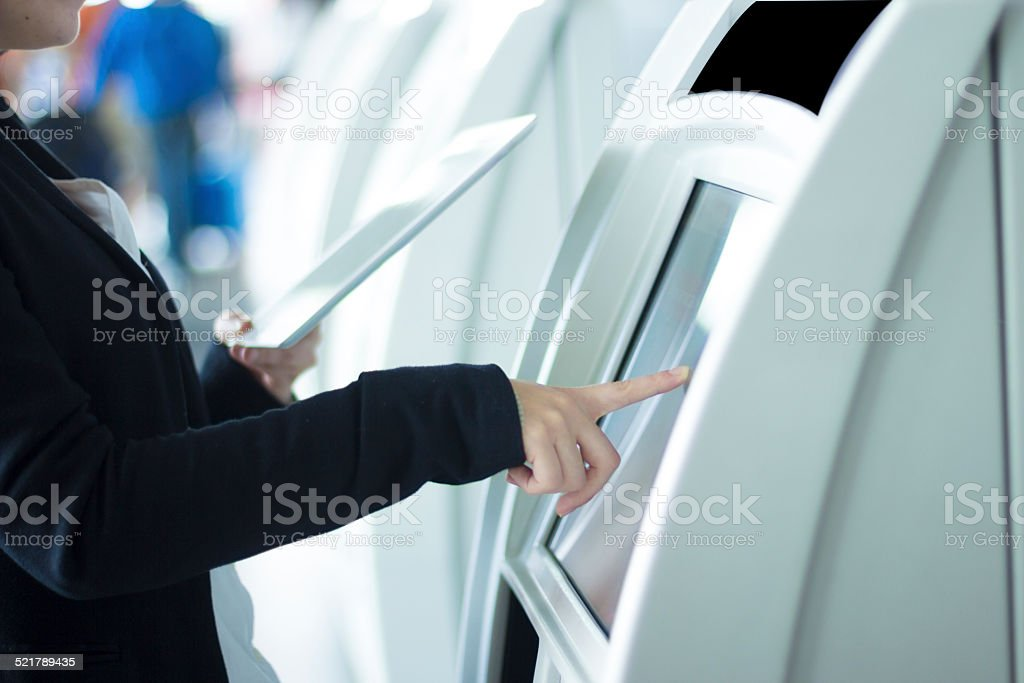 Woman doing check in at the airport stock photo