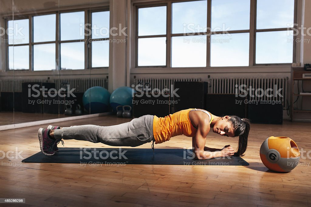 Woman doing core exercise in the gym stock photo