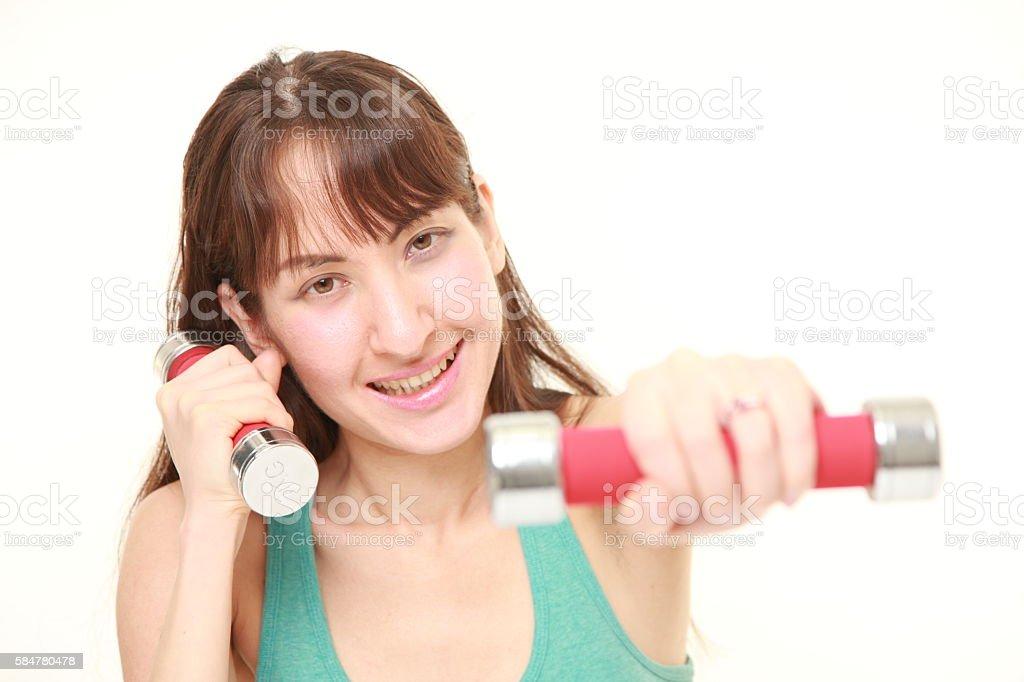 woman doing dumbbll exercise stock photo