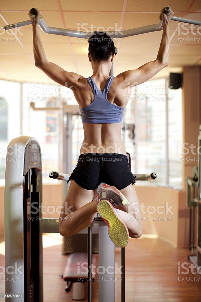 Woman doing exercise in fitnes club stock photo