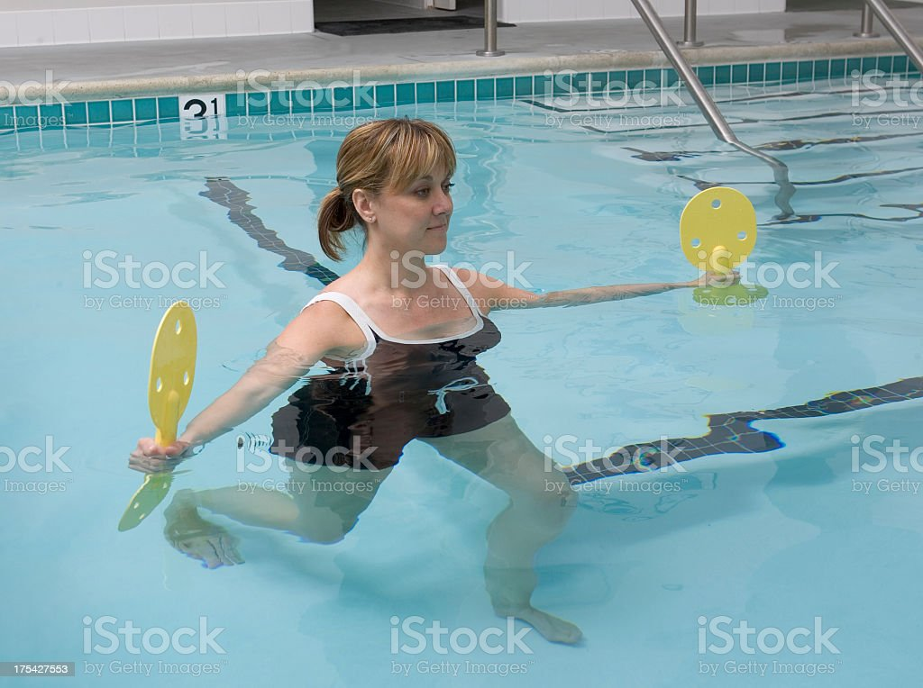 Woman doing exercise in the pool royalty-free stock photo