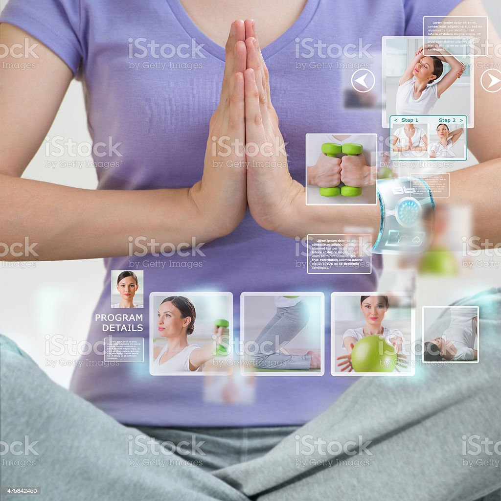 Woman doing exercise wearing smart wearable device with futurist stock photo