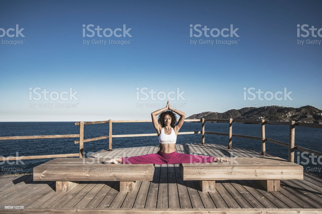 Woman doing exercises outdoors stock photo