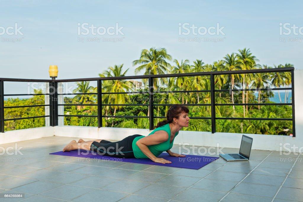 Woman doing exercises stock photo