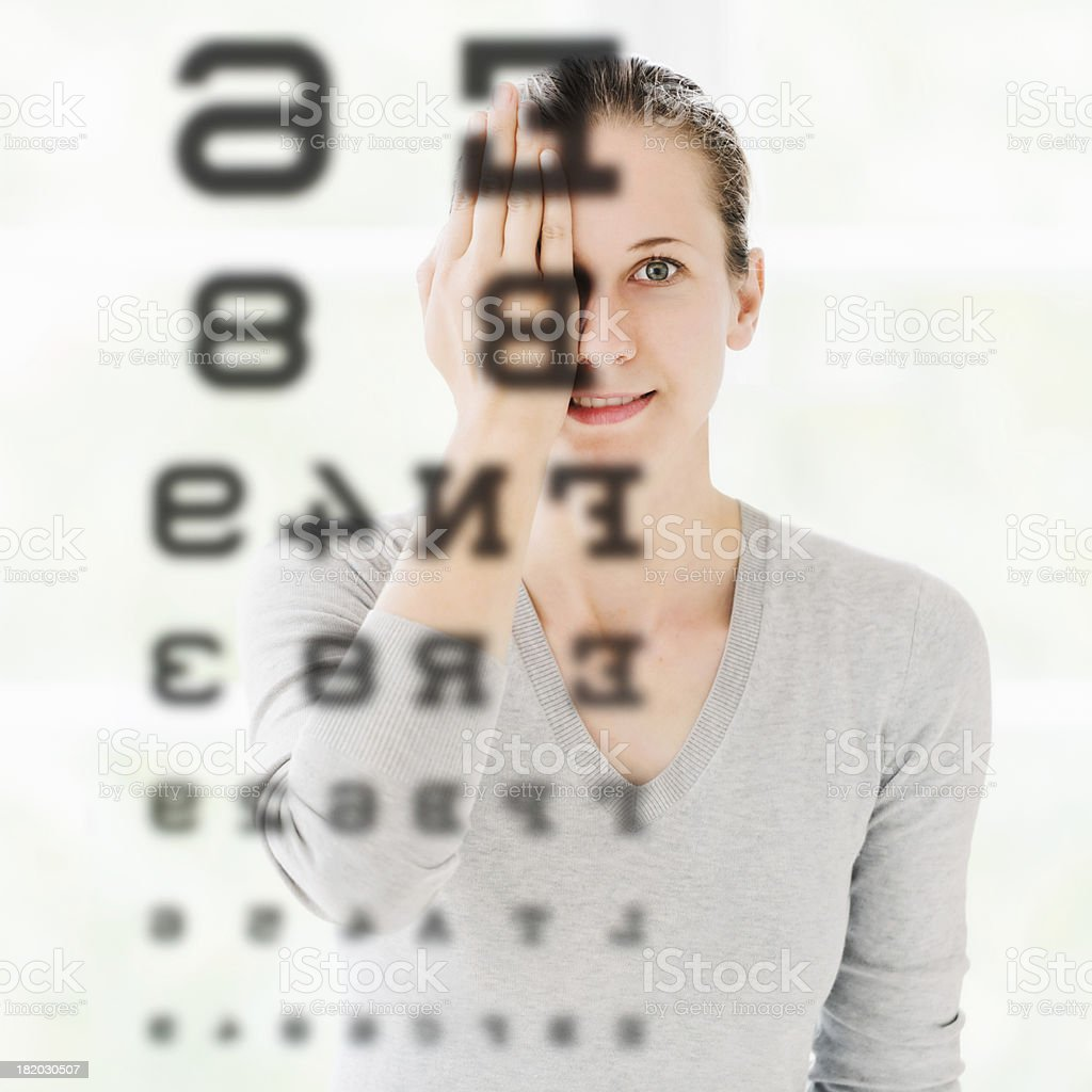 Woman Doing Eye Exam at Optometrist stock photo