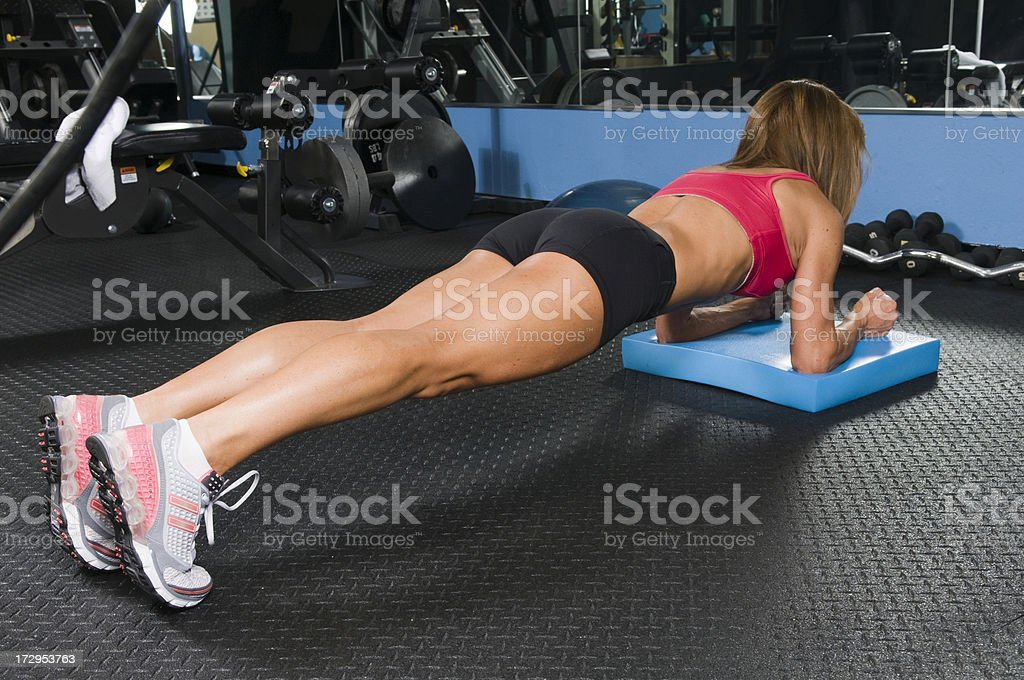 Woman Doing Floor Exercises stock photo